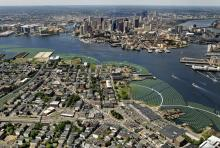Aerial view photo montage of the Emerald Tutu in Boston Harbor, here shown flanking and protecting the waterfront areas of East Boston. Image: The Emerald Tutu