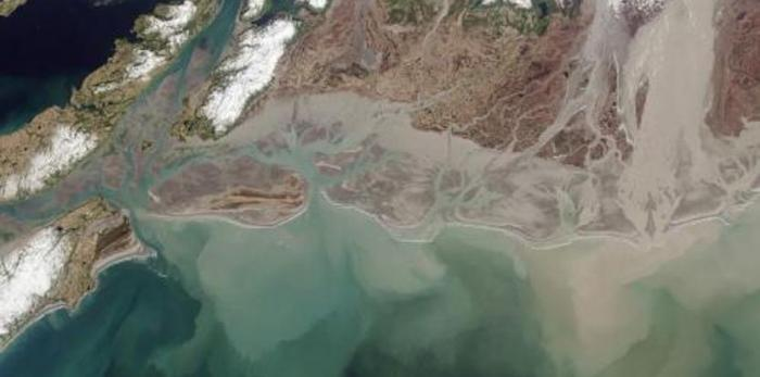 The Copper River in Alaska collects and moves large volumes of sediment, as seen from space.
